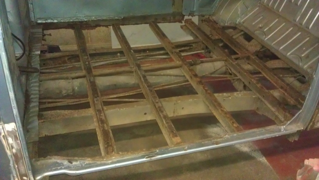 The rotten cargo floor was removed, and the front top hat section and inner B posts were replaced