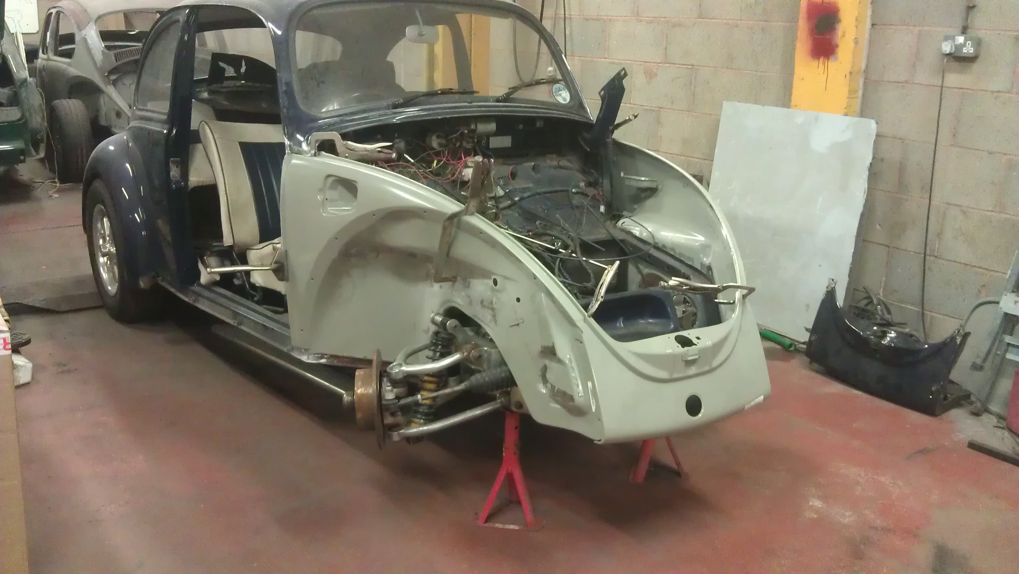 Genuine VW front quarters and valance were used. Lining the new parts up