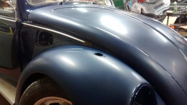 After paint we refitted the doors, bonnet and wings. The doors and quarters have been flatted and polished here, with the wings and bonnet flatted ready for a machine polish
